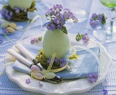 Pretty pastel with wild flower and sugar coated almonds make for this lovely Easter table decoration.