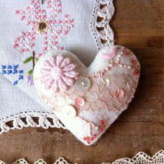 This would make a cute pin cushion! Small cream felt heart ornamnet textile art by BirdintheWoods, $20.00