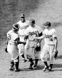 Brooklyn Dodgers catcher Roy Campanella, Jackie Robinson and Gil Hodges rush to shake bonus pitcher Sandy Koufax' hand after mowed down Redlegs with two-hitter. His 14 strikeouts established a NL high for this season. Baseball Tips, Dodgers Baseball, Better Baseball, Baseball Photos, Baseball Players, Baseball Cards, Angels Baseball, Baseball Season, Football