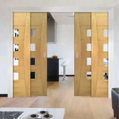 Deanta Quad Telescopic Pocket Pamplona Oak Flush Doors - Clear Glass - Prefinished.    #oakdoors  #slidingdoors  #moderndoors  #suistainabladeoors