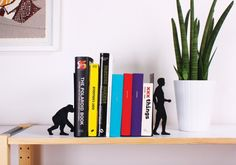 Depending on how you look at it, the Evolution Bookends and the books stacked between them are two pieces of metal or a symbolic representation of mankind' Metal Evolution, Book Dividers, Library Themes, Super Cool Stuff, Symbolic Representation, Book Holders, Book Stands, Coffee And Books, Stack Of Books