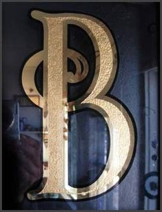 Glass Gilding 23k gold leaf window lettering Gold leafing on glass NYC Bob Gamache