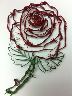 This is a beautiful Rose made out of barbed. Yeh man It will be a beautiful wall hanging on any wall, for anybody. you can have yours in any color you want.  It is $250