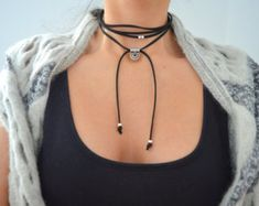 Item details:  Its a wrap choker made from genuine leather cord with a unique antique silver coin inspired by ancient Greek and Byzantine art, silver plated tube spacers, end caps and bars charms. This leather choker is made to wrap around your neck twice. It can be worn in many different ways, either tied loosely or tie it into a bow.  If you require a shorter or longer length please let me know at checkout…