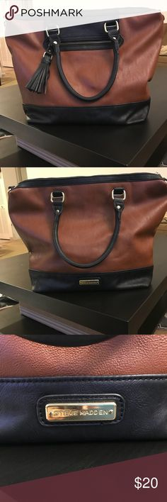 Steve Madden handbag Brown handbag with black and gold accents all over. Trendy tassel with zippered pocket in the front. Roomy interior with black/white design. Interior zippered pocket and side pockets for cell phones, money, etc. Steve Madden Accessories