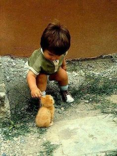 Lil' one and kitty =) Cute =)