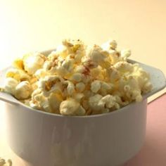 Cheesy Popcorn -- Freshly grated Parmesan cheese and a sprinkle of cayenne pepper dress up air-popped popcorn. #healthy #snack