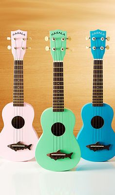Bright ukuleles with shark bridge design. This would be perfect for the Bay!