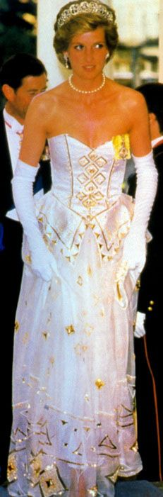 The Emanuels' (wedding dress designers) corset topped ballgown first appeared at a Red Cross ball in July, 1986 and Bond movie premiere in June, 1987.