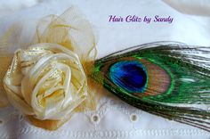 $7.00 Beautiful peacock feather with hand rolled rose of ivory and gold on a gold tulle puff.  It has both an alligator clip and a pin back to make it perfect for your hair or wear it as a brooch.  Available now a www.hairglitzbysandy.etsy.com