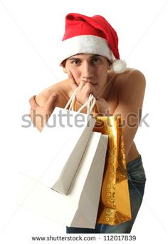 Young Muscular Sexy Man Wearing A Santa Claus Hat With Copy Space ...
