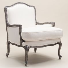 This colonial French armchair is as lovely to look at as it is comfortable to sit in! The gorgeously sculpted wooden frame has delicate carved details running continuously along all edges of the frame and ornate scroll work featured on the turned out feet.