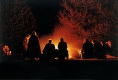 Sitting by a campfire, singing songs, telling stories, enjoying the night. and don't forget, ROASTING MARSHMALLOWS! :)