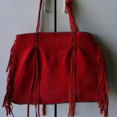 Zara fringe tote Red suede tote with fringe design. Includes an attached zip pouch.   Add a striking red accessory to your black moto jacket!   Used with signs of wear and stain on pouch. Please see photo and let me know if you have ?. Still in good condition Zara Bags Totes