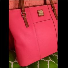 "Sunday sale-NWOT Dooney & Bourke hot pink Tote NWOT Dooney & Bourke Pebble Leather Lexington Shopper. This bright hot pink bag is sure to turn heads this spring season! I received as a birthday gift, but already have this bag (and let me brag about how many compliments I receive when using it). The perfect size for everyday use. it's in perfect condition. H 10.5"" x W 3.5"" x L 11.75"". Four inside pockets. Inside key hook. Strap drop length: 13"". Front and back slip pockets. Lined. Feet…"