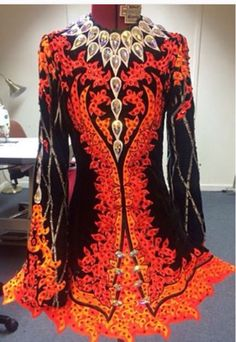 **Celtic Star**Irish Dance Solo Dress Costume**  In a glut of flame dresses, this one stands out because it truly looks on fire.  It has the same flattering black velvet on either side of the waist that I've seen before too.  Very slenderizing.