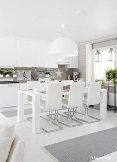 White floorboards aren't the most practical or durable option, but they are very trendy and stylish at the moment and many design fans are painting their Kitchen Dinning Room, Dining Room Design, Interior Design Living Room, Kitchen Decor, Dining Table, Kitchen Grey, Design Interior, Living Room Scandinavian, Scandi Home