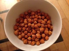 Roasted chickpeas  Snack time!! I use these as a sort of peanut replacement. Tasty and so easy.  1 tin of chickpeas drained.  Spices (paprika, cayenne pepper, salt and pepper)  Spray oil  Preheat oven to 200 degrees Celcius.  Put chickpeas on a baking tray and spray with oil  Sprinkle seasonings on top.  Bake for 30 min or until crunchy.  BEWARE.  THEY CAN POP SO BE CAREFUL OPENING THE OVEN!!