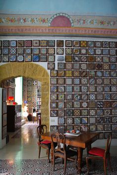 """Stanze al Genio"" in Palermo, a collection of tiles displayed on the walls. Visits are possible { more into at www.stanzealgenio.it }"