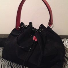 KATE SPADE New York purse Lk❤️HOST PICK❤️ KATE SPADE. Out did herself with this amazing number. Very cute ladies and it won't last. Black nylon with pink leather strap and draw string. Silver hardware, and feet. The poke a dot lining has a zippered pocket. Carried once. Extremely gorgeous!! Like I said wont last long or I might just change my mind and keep it.  kate spade Bags Hobos