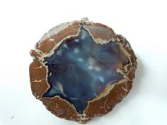 A thunderegg is a nodule-like geological structure, similar to a geode, that is formed within a rhyolitic lava flow. Thundereggs are rough spheres, most about the size of a baseball - though they can range from less than an inch to over a meter across. They usually contain centres of chalcedony in the form of agate, jasper or opal, either uniquely or in combination. Also frequently encountered are quartz and selenite crystals, as well as various other mineral growths and inclusions.