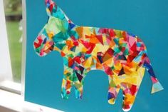 Piñata Suncatchers for a Cinco de Mayo  Craft.  Made theses and they were adorable!  Such a great way to do any sun-catcher craft.  Cutting out the burro was a good challenge for the older kids.