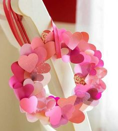 Create a heart wreath with pretty card stock and scrapbooking papers. Use paper punches or scissors to cut out hearts, then curl by scraping them as you would curling ribbon. Layer and glue to a cardstock base.