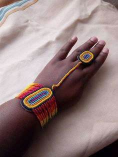 This bracelet comes with a ring made of beads. Its mainly worn during weddings. Its a good accessory for a kitenge outfit. The bracelet was mainly used by the Zulu during traditional weddings. African Bracelets, African Necklace, African Beads, African Jewelry, Ethnic Jewelry, Unique Jewelry, Latest African Fashion Dresses, African Print Fashion, Hand Jewelry