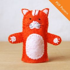 This is a PDF pattern for a cat finger puppet. The pattern contains step-by-step instructions and illustrations to show you how to complete your