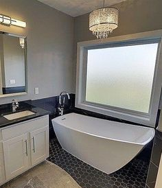 """The @drakehomesiowa are known for their modern style and leaving no detail untouched. Interior designer @designluvah13 worked on this master bath using our Stella Freestanding Bath as the focal point. """"The asymmetric lines spacious bathing well high back convex corners and overall sleek design are the many reasons I have so much love for this tub"""" says Amber.  #jacuzziluxurybath #ferguson #freestandingbath #bathroom #masterbath #interiordesigner #bathtub #dreambathroom #bathroom…"""