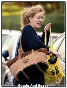 Adele stepped out of her London Home with her Dachshund, Louie