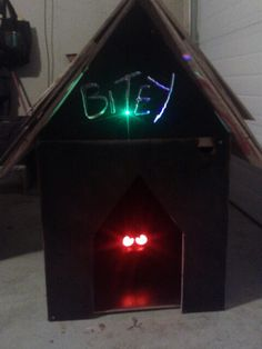 New halloween prop. Haunted doghouse with haunted hedge eyes inside