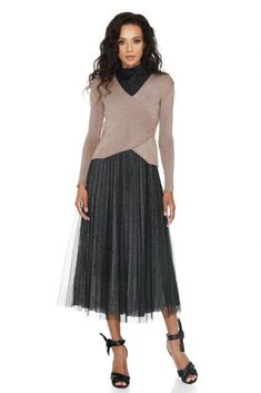 Bedazzle them in this Vero Milano turtleneck dress with nude blouse overlay, featuring full skirt tulle finishing and a flattering wrap-up effect top.