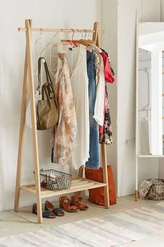I just love this wooden clothing rack for small spaces! Wood Clothing Rack, Clothes Racks, Wooden Clothes Rack, Clothes Storage, Wooden Rack, Clothes Stand, Hanging Clothes, Cheap Home Decor, Diy Home Decor