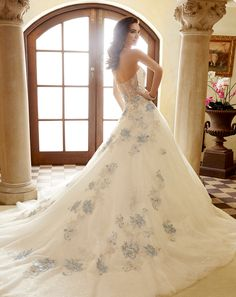 wedding dresses with blue details - http://ruffledblog.com/french-riviera-inspired-wedding-gowns-from-sophia-tolli
