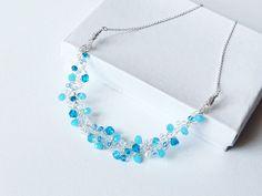 Unique crochet wire bib necklace. Aqua blues lacy  by ByDrora