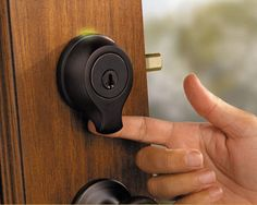 """This Kwikset deadbolt door lock has a sensor beneath the lock cylinder, allowing you to program the lock to read fingertips to unlock the door. The door can """"learn"""" 50 people's fingertips. Need a handyman? You can program his fingertip into the lock for one day, and deny him access later. And you can still use a good, old-fashioned key if you prefer."""