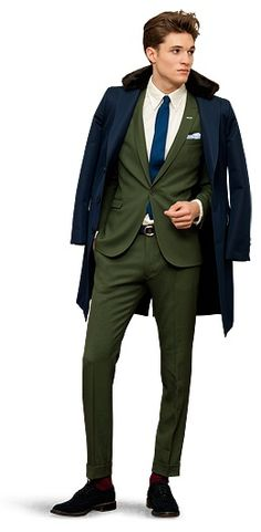 There are a few things about this outfit that I don't like, but somehow it all works together. I love dark green suits, but the blue tie clashes a bit. I also would have picked a different pair of socks and shoes, but he looks like he knows what he's doing.