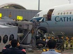 AN air bridge has reportedly collapsed at Hong Kong's airport ripping the door from a Cathay Pacific plane and injuring at least one person.