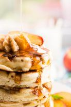 An easy recipe for extra light and fluffy peach pancakes that come together in no time! My family loves these for breakfast on the weekends! | savorynothings.com