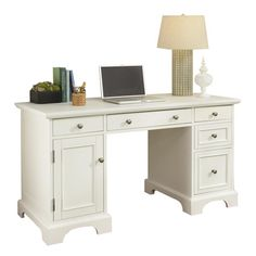 A charming addition to your master suite or home office, this chic wood desk features 4 drawers and a file cabinet.       Product:...