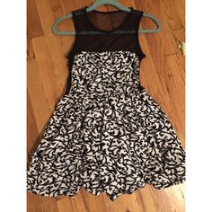 Motel Rocks Black & white shear back mini dress Cotton black and white patterned dressed lined with shear black fabric along the top and back of the dress. Flares out at the waist. Urban Outfitters Dresses Mini