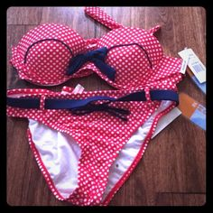 🎉HostPick🎉New with tags vintage inspired bikini Please note in second photo there is a small black dot. I received the swimsuit with that spot. I have not washed (due to not wanting to remove the tags) price reflects spot :) Mocena Swim Bikinis