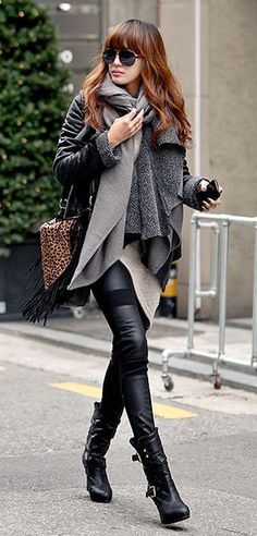 Keep yourself warm this winter but at the same time look amazing. Partner your scarf with a matching coat and tight jeans. Finish the look with some deadly black boots.