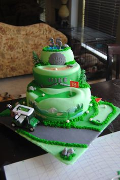Golf Course Multi-Scene Cake - Hand made balls, tees, pond, sand pit, rake etc. Cart, trees and golf back drop are the only things I didn't hand make on this cake.