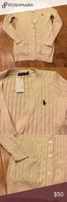 Ralph Lauren Polo women's v neck L Brand new with tags on.  Really beautifully made and really warm.  Love that it has pockets.  It was bought from. Ralph Lauren store and is authentic. Polo by Ralph Lauren Sweaters Cardigans