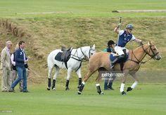 Prince Charles, Prince of Wales looks on as Prince Harry plays at the Gigaset Charity Polo Match at Beaufort Polo Club on June 14, 2015 in Tetbury, England.