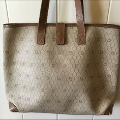 Vintage Cristian Dior tote. Vintage Cristian Dior tote. Usage shown in photos, handles in tact, still much more use in this handbag, able to fit a lab top, binders in his tote, very rare. Dior Bags Totes