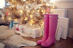 Hunter boots in hot pink shinny adult sized