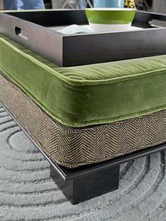 DIY project ottoman doubles as coffee table.  Pillows can be pulled off the base and used as throw pillows on the floor for extra seating.  Love these colors.